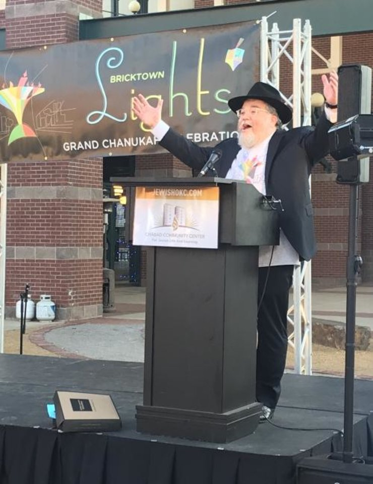 Photo -  Rabbi Ovadia Goldman, spiritual leader of the Chabad Community Center for Jewish Life and Learning, welcomes the crowd to the