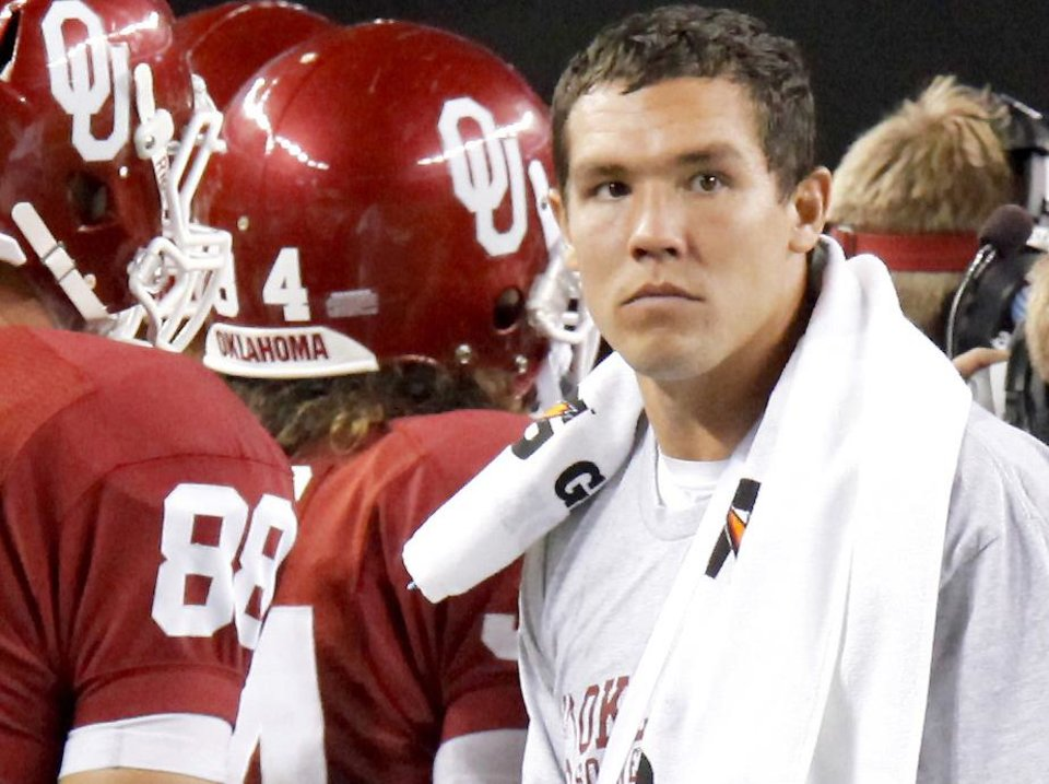 Photo - The biggest question surrounding the Oklahoma football program remains: Will injured Heisman winner Sam Bradford be ready in time to play at ninth-ranked Miami next weekend? Photo by Bryan Terry, The Oklahoman