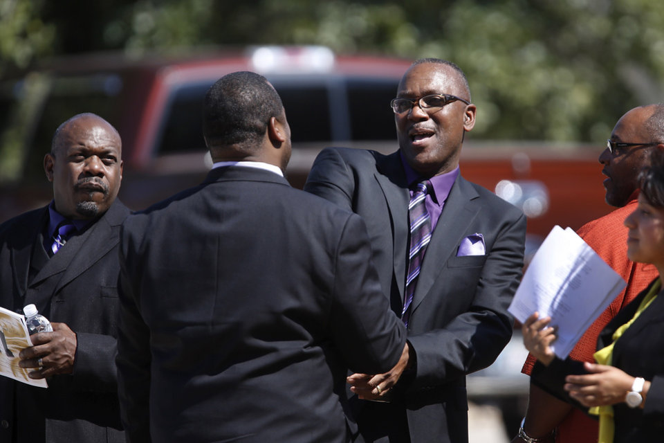 Former major league baseball player Joe Carter, Jr.,  greets a friend  after the funeral.  About 400 family and friends gathered inside the Millwood High School Fieldhouse on  Tuesday,  Sep, 25, 2012, to honor the life and say farewell to Joseph D. Carter, Sr. at a funeral service that was sentimental and touching, but also full of joy and laughter. Carter is survived by a wife and their 11 children as well as 46 grandchildren, 35 great-grandchildren and 10 great-great-grandchildren. Photo by Jim Beckel, The Oklahoman.