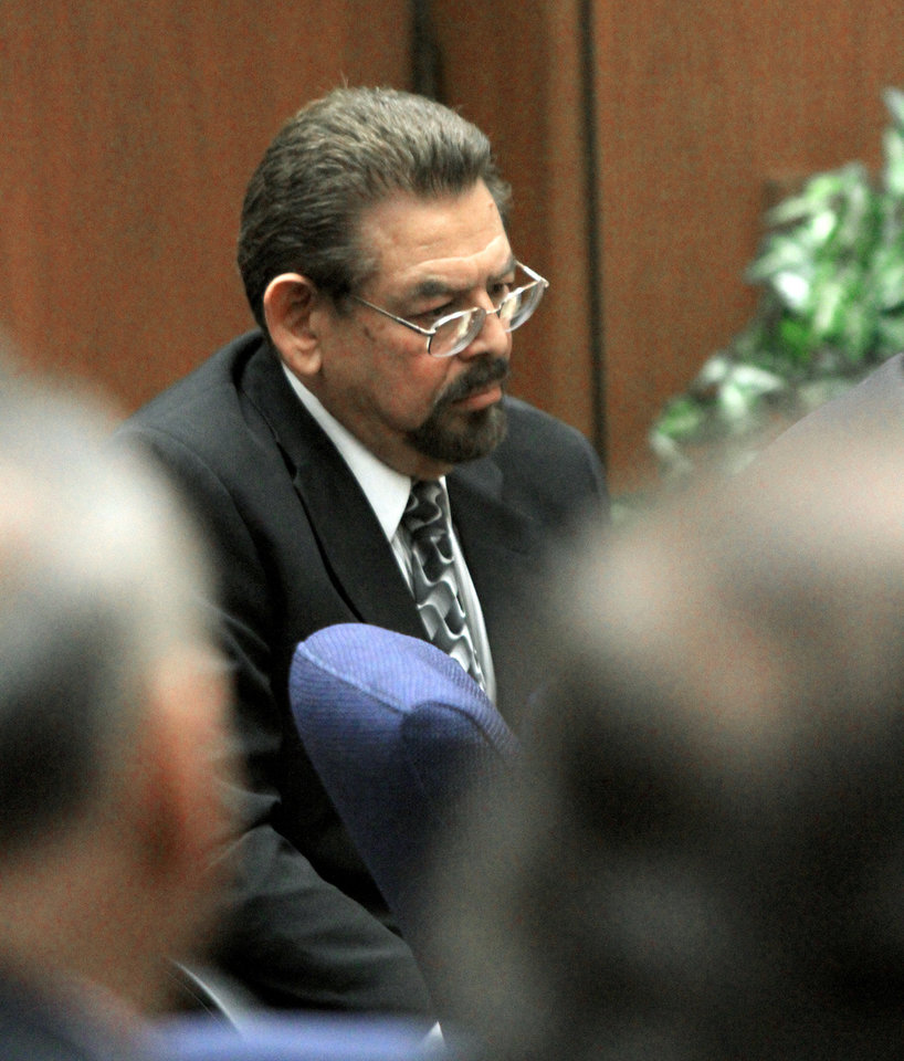 George Mirabal,  a former Bell City elected official listens to the judge as a guilty verdict is read in his trial on Wednesday, March 20, 2013, in Los Angeles.  Mirabal and four former elected officials were convicted of multiple counts of misappropriation of public funds, and a sixth defendant was cleared entirely. Former Mayor Oscar Hernandez and co-defendants Mirabal, George Cole, Teresa Jacobo, and Victor Belo were all convicted of multiple counts and acquitted of others.  The charges against them involved paying themselves inflated salaries of up to $100,000 a year in the city of 36,000 people, where one in four residents live below the poverty line.   (AP Photo/Los Angeles Times, Irfan Khan, Pool)