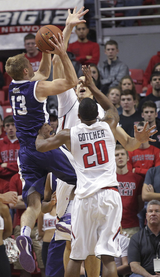 Photo - TCU's Christian Gore shoots over Texas Tech's Dejan Kravic and Toddrick Gotcher during an NCAA college basketball game in Lubbock, Texas, Saturday, Feb, 1, 2014. (AP Photo/Lubbock Avalanche-Journal, Tori Eichberger) LOCAL TV OUT