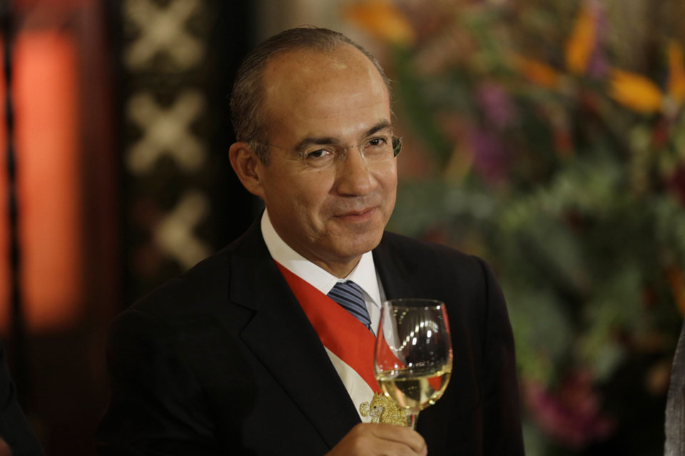 Photo - Mexico's President Felipe Calderon raises his glass during his last state dinner in Mexico City, Friday, Nov. 30, 2012. The party that ruled Mexico for seven decades returns to power Saturday with a president from a new generation to govern a country that has changed dramatically in the 12 years since the Institutional Revolutionary Party last held the top post. (AP Photo/Dario Lopez-Mills)