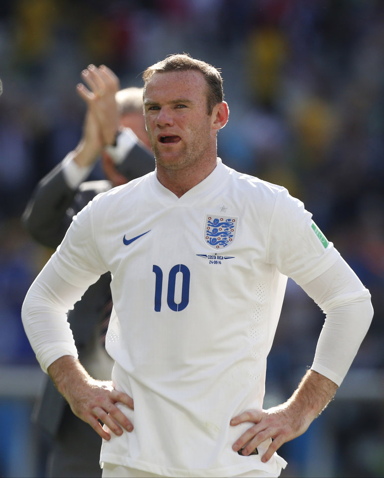 Photo - England's Wayne Rooney stands in front of England fans after the group D World Cup soccer match between Costa Rica and England at the Mineirao Stadium in Belo Horizonte, Brazil, Tuesday, June 24, 2014.  The match ended in a 0-0 draw. (AP Photo/Jon Super)