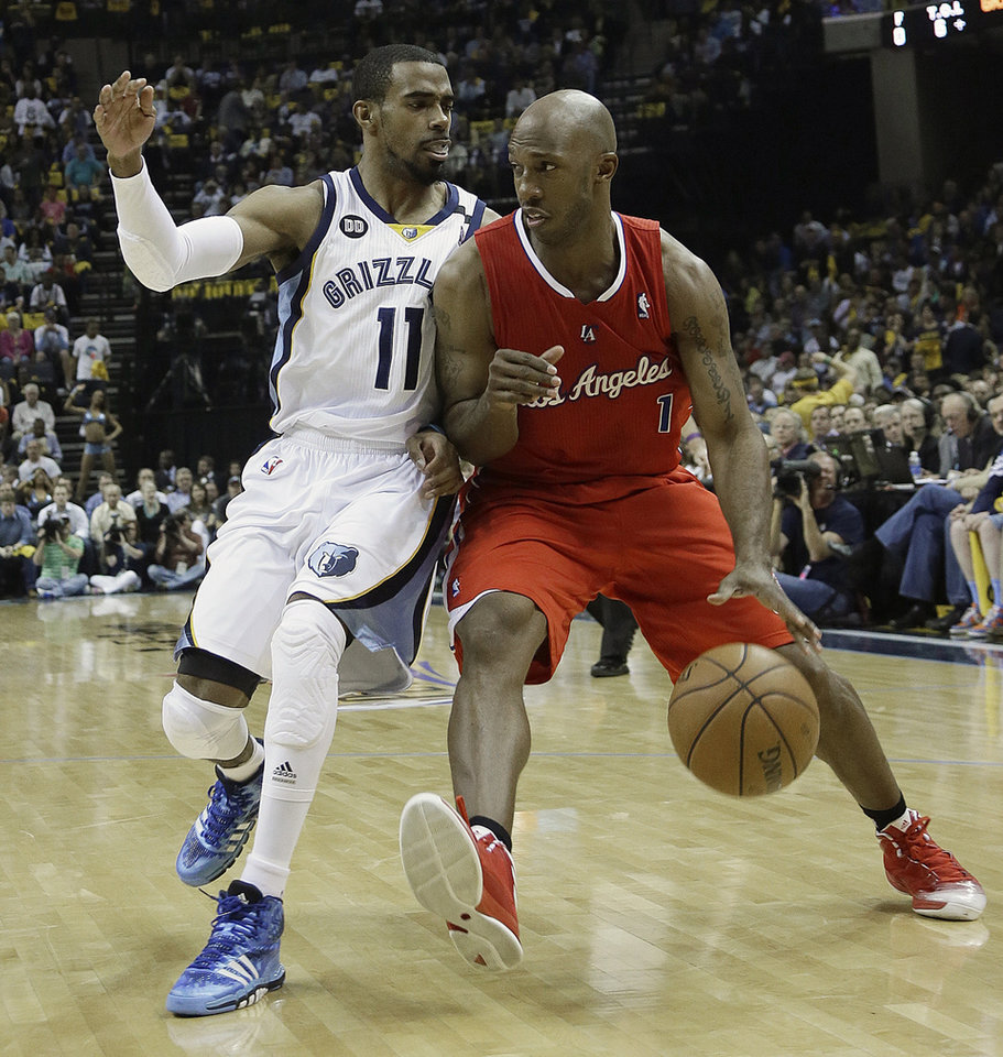 Photo - Los Angeles Clippers guard Chauncey Billups (1) moves the ball against Memphis Grizzlies guard Mike Conley (11) during the first half of Game 3 in a first-round NBA basketball playoff series, in Memphis, Tenn., Thursday, April 25, 2013. (AP Photo/Danny Johnston)