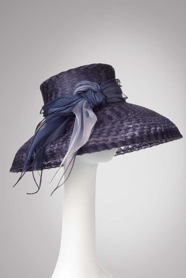 This hat is an example of the millinery fashions of Marla Cook. She and Lydia Sullivan-Benham will present a hat trimming workshop from 1 to 4 p.m.  Feb. 23 at JRB Art at the Elms, 2810 N Walker. Photo provided. <strong></strong>