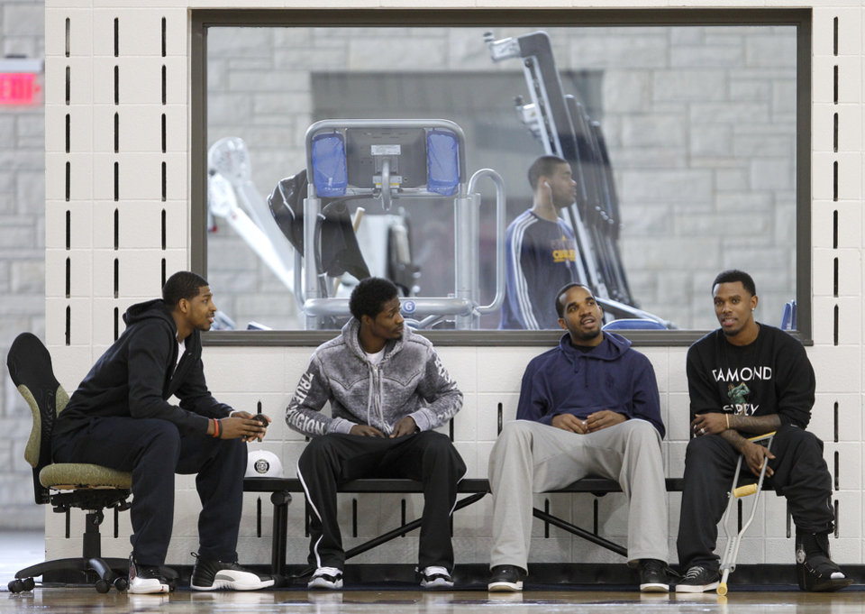 Photo -   With their season ended, Cleveland Cavaliers players, from left, Tristan Thompson, Manny Harris, Alonzo Gee and Daniel Gibson talk together before speaking to the media at the team's practice facility in Independence, Ohio, on Friday, April 27, 2012. (AP Photo/Amy Sancetta)