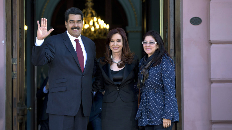 Photo - Venezuela's President Nicolas Maduro, left, and his long time partner Cilia Flores, right, pose for a picture with Argentina's President Cristina Fernandez at the government house in Buenos Aires, Argentina, Wednesday, May 8, 2013. Maduro is on a South American tour that began in Uruguay and will end in Brazil. (AP Photo/Natacha Pisarenko)
