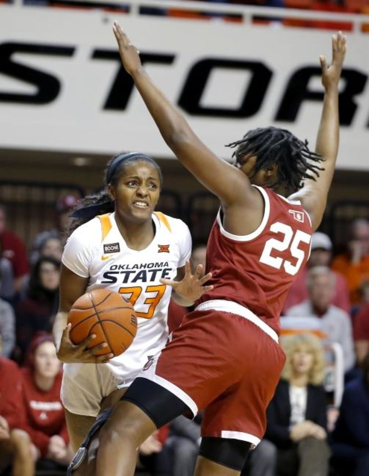 Photo -  Oklahoma State's Clitan de Sousa, left, tries to get past Oklahoma's Madi Williams during Wednesday night's Bedlam women's basketball game at Gallagher-Iba Arena in Stillwater. OU won the game, 77-75. [Bryan Terry/The Oklahoman]