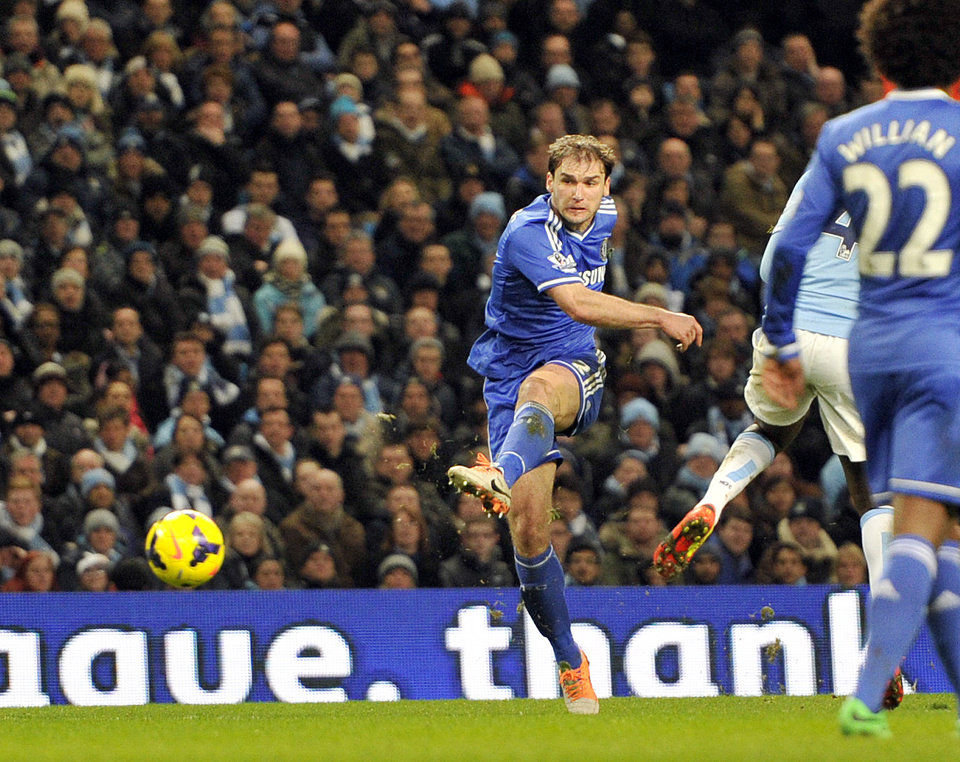 Photo - Chelsea's Branislav Ivanovic scores the first goal of the game for his side during their English Premier League soccer match against Manchester City at the Etihad stadium in Manchester, England, Monday Feb. 3, 2014. (AP Photo/Clint Hughes)