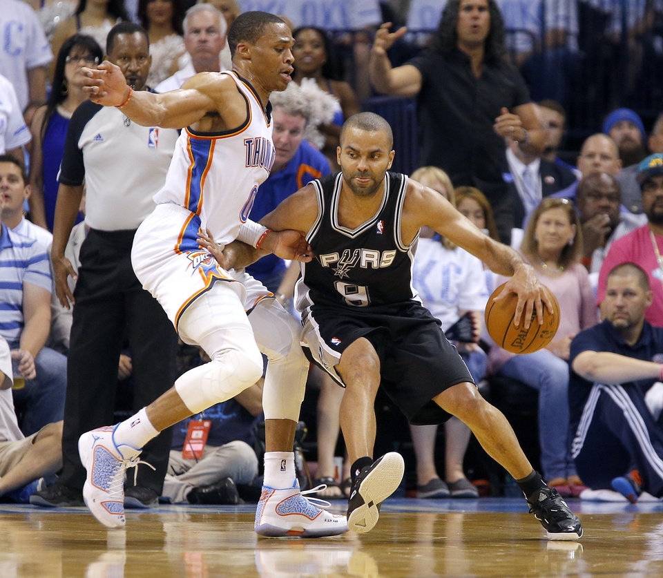 Photo - Oklahoma City's Russell Westbrook (0) defends against San Antonio's Tony Parker (9) during Game 6 of the Western Conference Finals in the NBA playoffs between the Oklahoma City Thunder and the San Antonio Spurs at Chesapeake Energy Arena in Oklahoma City, Saturday, May 31, 2014. Photo by Bryan Terry, The Oklahoman