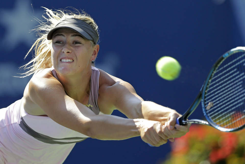 Photo -   Maria Sharapova, of Russia, returns a shot to Mallory Burdette in the third round of play at the 2012 US Open tennis tournament, Friday, Aug. 31, 2012, in New York. (AP Photo/Mike Groll)