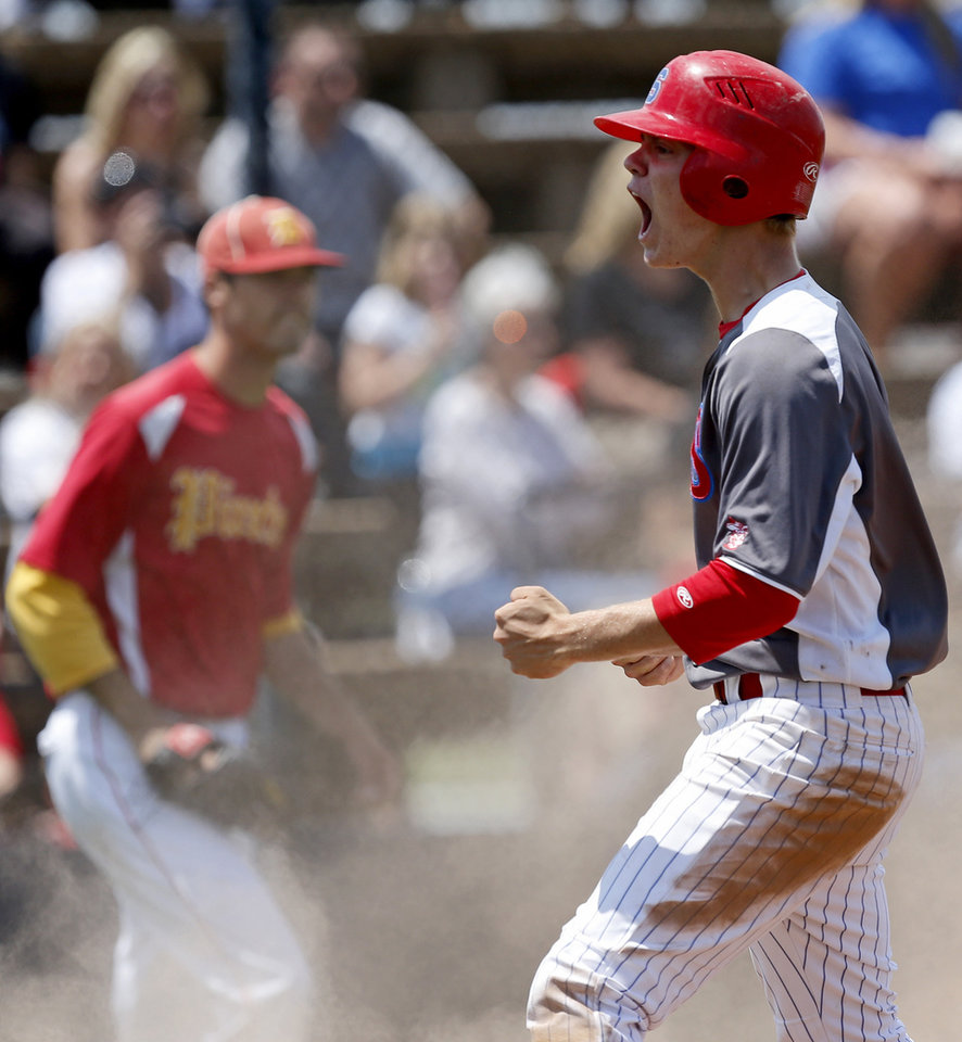 Silo's Leonard Sandler celebrates after scoring in the fourth inning against Dale  during the Class 2A state baseball tournament championship game in Shawnee, Okla., Saturday, May 11, 2013. Photo by Bryan Terry, The Oklahoman
