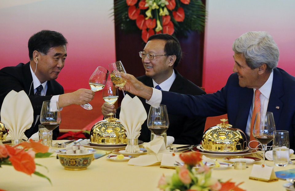 Photo - China's Vice Premier Wang Yang, left, and State Councilor Yang Jiechi, center, share a toast with U.S. Secretary of State John Kerry before a working lunch at the U.S.-China Strategic and Economic Dialogue known as the