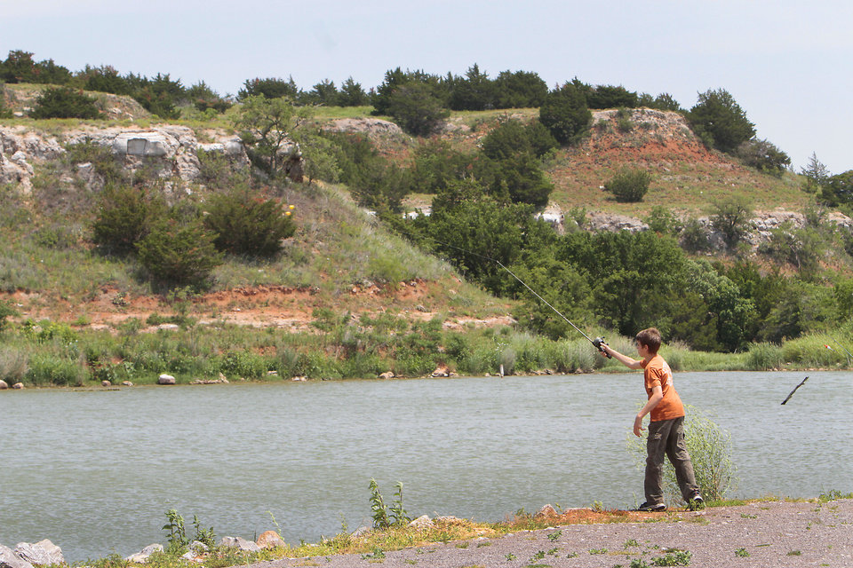 Photo - A young man cast a line while fishing at  at Roman Nose State Park, Tuesday , May 22, 2012. Photo By David McDaniel/The Oklahoman