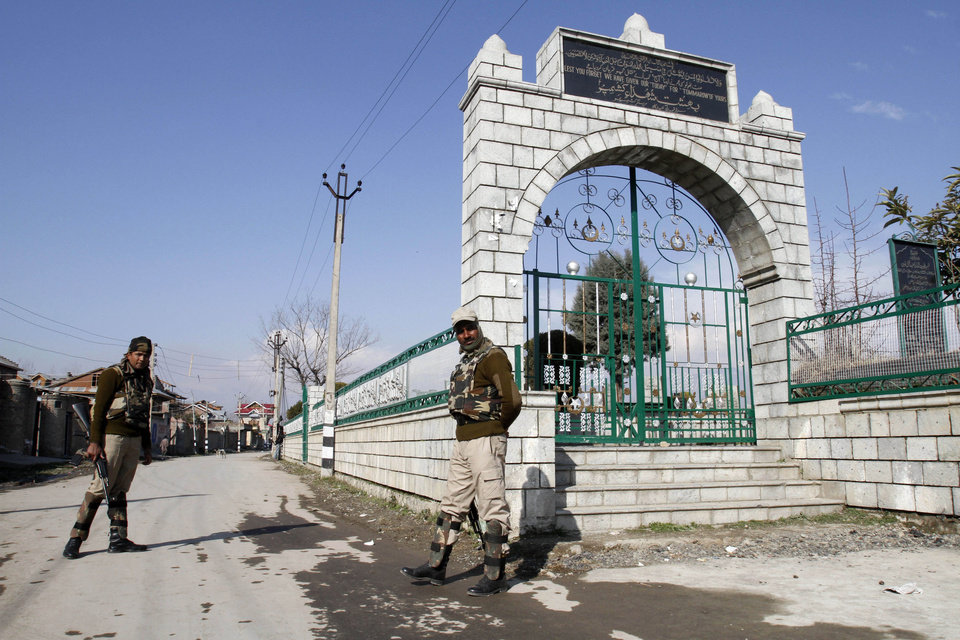"Indian paramilitary soldiers stand guard in front of the Martyr's Graveyard restricting entry into the graveyard in Srinagar, India, Tuesday, Feb. 12, 2013. Separatist politicians called for a mass funeral prayer for Mohammed Afzal Guru, the Kashmiri man convicted in a deadly attack on India's Parliament, to be held Friday at a large square near Srinagar's Martyr's Graveyard, where hundreds of separatists and civilians killed in the conflict are buried. Unknown residents have, meanwhile, put up a tombstone as a mark over an empty grave for Guru in the main martyr's graveyard in Srinagar. The epitaph reads: ""His mortal remains are lying in trust with the government of India. Kashmiri nation awaits its return."" (AP Photo/ Mukhtar Khan)"