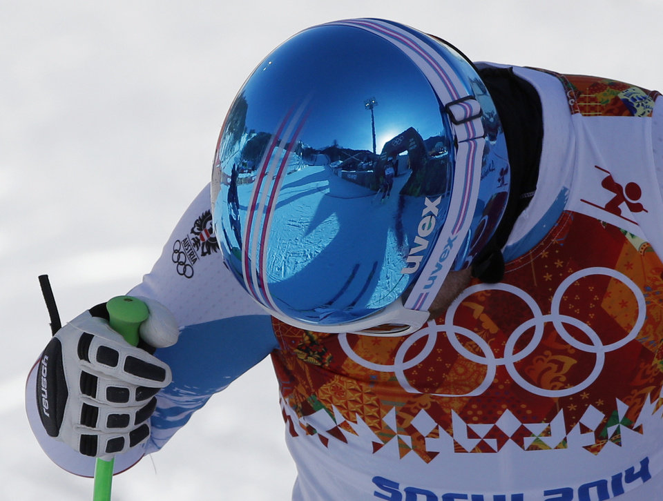 Photo - The finish area is reflected in the helmet of Austria's Klaus Kroell at the end of a men's downhill training run for the 2014 Winter Olympics, Friday, Feb. 7, 2014, in Krasnaya Polyana, Russia. (AP Photo/Christophe Ena)