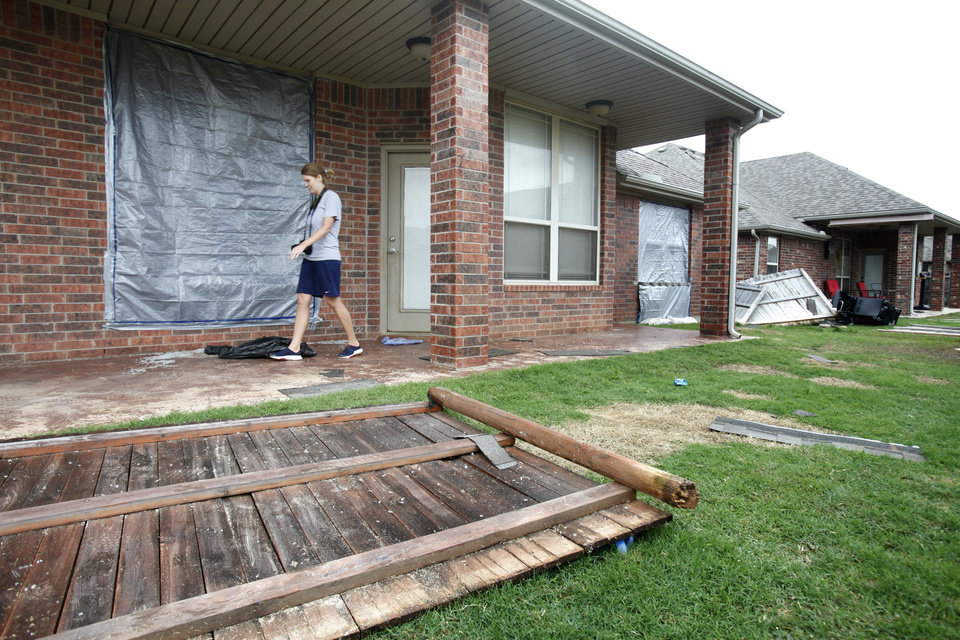 The Mustang home of Amy Schachle, 550 W. Geronimo Courtway, was damaged by a small tornado that touched down early Saturday. <strong>PAUL HELLSTERN - Oklahoman</strong>