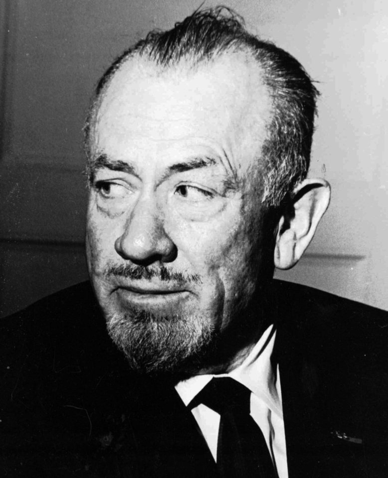 Photo - **FILE**  This 1965 file photo shows author John Steinbeck winner of the 1962 Nobel Prize for literature.   (AP Photo/File)   - AP