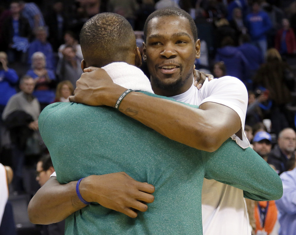 Photo - Oklahoma City's Kevin Durant (35) hugs Boston's Jeff Green (8) following the NBA game between the Oklahoma City Thunder and the Boston Celtics at the Chesapeake Energy Arena., Sunday, Jan. 5, 2014. Photo by Sarah Phipps, The Oklahoman