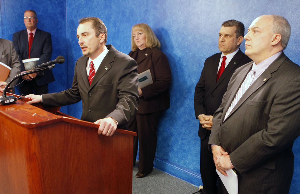 Photo - FILE: OPEA Executive Director Sterling Zearley speaks to members of the press about his organization  filing an injunction to block an open records request by The Oklahoman, during a press conference at the state Capitol in Oklahoma City, OK, Monday, March 29, 2010. To the right is State Rep. Randy Terrill (R-Moore).  By Paul Hellstern, The Oklahoman ORG XMIT: KOD
