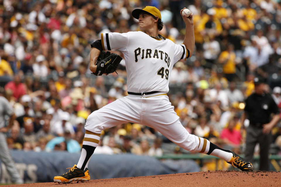 Photo - Pittsburgh Pirates starting pitcher Jeff Locke (49) delivers during the first inning of a baseball game against the Milwaukee Brewers in Pittsburgh Sunday, June 8, 2014. (AP Photo/Gene J. Puskar)