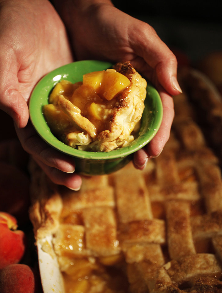Photo - FOOD: A dish filled peach cobbler made from locally grown Oklahoma peaches. Photo by K.T. KING, The Oklahoman