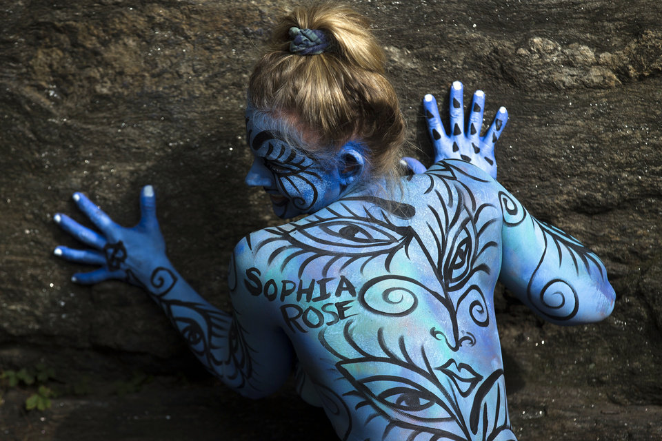 Photo - AP10ThingsToSee - Debbie McCabe, of New Jersey, poses after being painted at Columbus Circle as body-painting artists gathered to decorate nude models during an event featuring artist Andy Golub, Saturday, July 26, 2014, in New York. (AP Photo/John Minchillo)