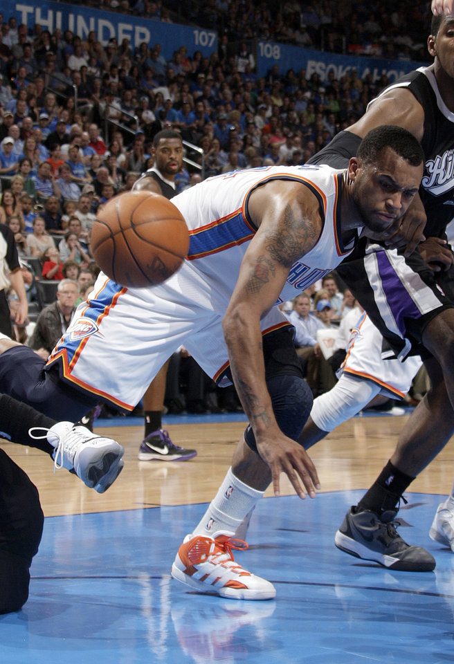 Oklahoma City's Daequan Cook (14) tries to save a loose ball during the NBA basketball game between the Oklahoma City Thunder and the Sacramento Kings at Chesapeake Energy Arena in Oklahoma City, Tuesday, April 24, 2012. Photo by Sarah Phipps, The Oklahoman.