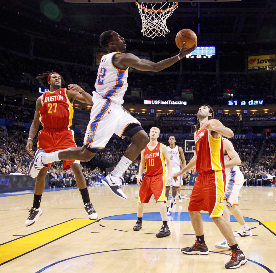 Photo - Oklahoma City's Jeff Green goes to the basket between Houston's Jordan Hill, left, and Luis Scola during the NBA basketball game between the Oklahoma City Thunder and the Houston Rockets at the Oklahoma City Arena on Wednesday, December 15,  2010.   Photo by Bryan Terry, The Oklahoman