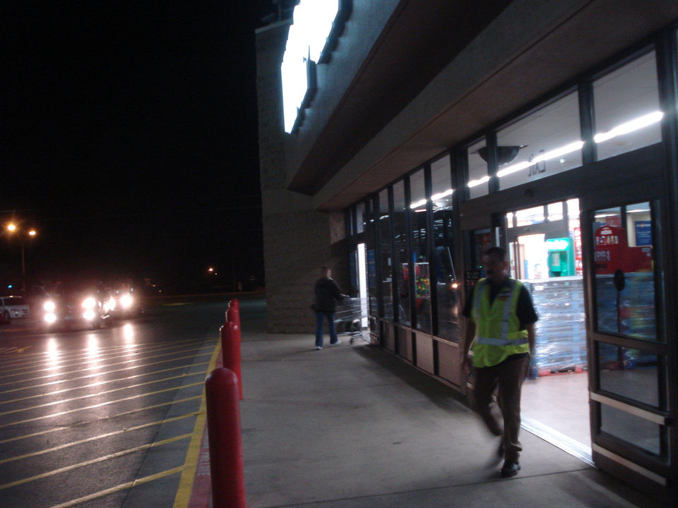 Photo - BLACK FRIDAY / DAY AFTER THANKSGIVING / CHRISTMAS / HOLIDAY / SHOPPING / SHOPPERS / SHOP: The Elk City Walmart doorway is shown about 4:30 a.m. Friday. It is empty because, unlike previous years, the store did not close in advance of the 5 a.m. sale. BY JIM STAFFORD,  FOR THE OKLAHOMAN     ORG XMIT: 0911271828551594