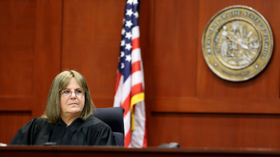 Photo - Judge Debra Nelson listens to a prospective juror in Seminole circuit court during the George Zimmerman trial, in Sanford, Fla., Tuesday, June 11, 2013. Zimmerman has been charged with second-degree murder for the 2012 shooting death of Trayvon Martin.(AP Photo/Orlando Sentinel, Joe Burbank, Pool)