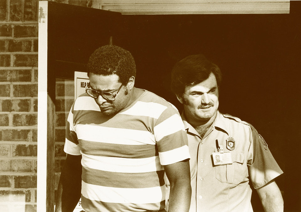 Photo - Right: In this archive photo, Capt. Lewis McGee, left, is escorted by a security officer after being freed by rioting prisoners at the Mack Alford Correctional Center in Stringtown in 1988.  PHOTO BY David McDaniel, OKLAHOMAN ARCHIVE