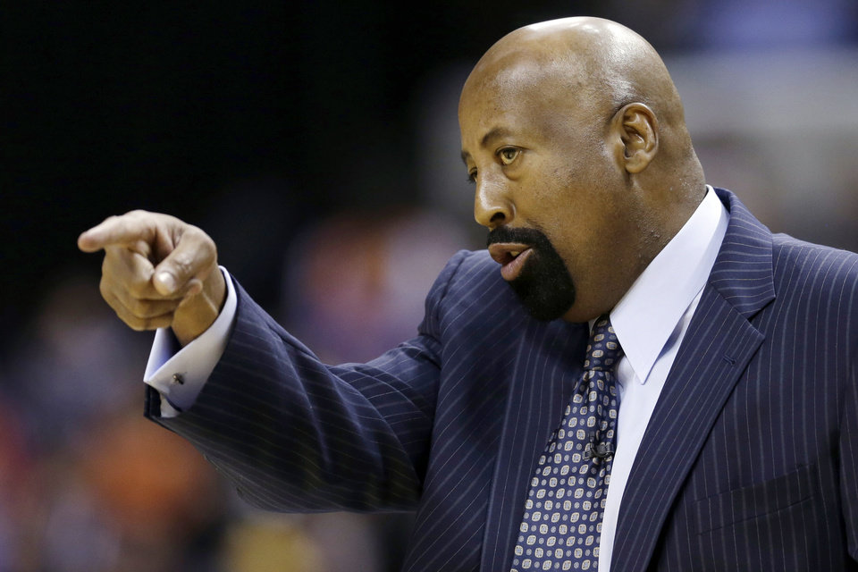 New York Knicks head coach Mike Woodson gives directions to his team during the first half of an NBA basketball game against the Indiana Pacers, Thursday, Jan. 10, 2013, in Indianapolis. (AP Photo/Darron Cummings)
