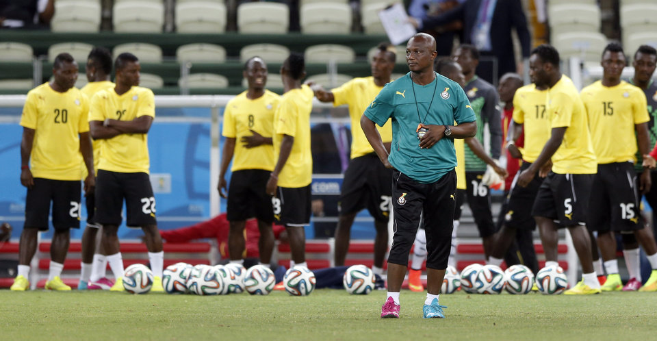 Photo - Ghana's head coach Akwasi Appiah arrives for an official training session the day before the group G World Cup soccer match between Germany and Ghana at the Arena Castelao in Fortaleza, Brazil, Friday, June 20, 2014. (AP Photo/Matthias Schrader)