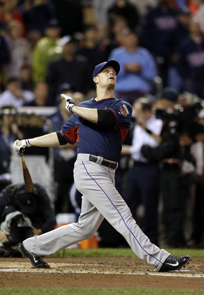 Photo - National League's Justin Morneau, of the Colorado Rockies, hits during the MLB All-Star baseball Home Run Derby, Monday, July 14, 2014, in Minneapolis. (AP Photo/Jeff Roberson)