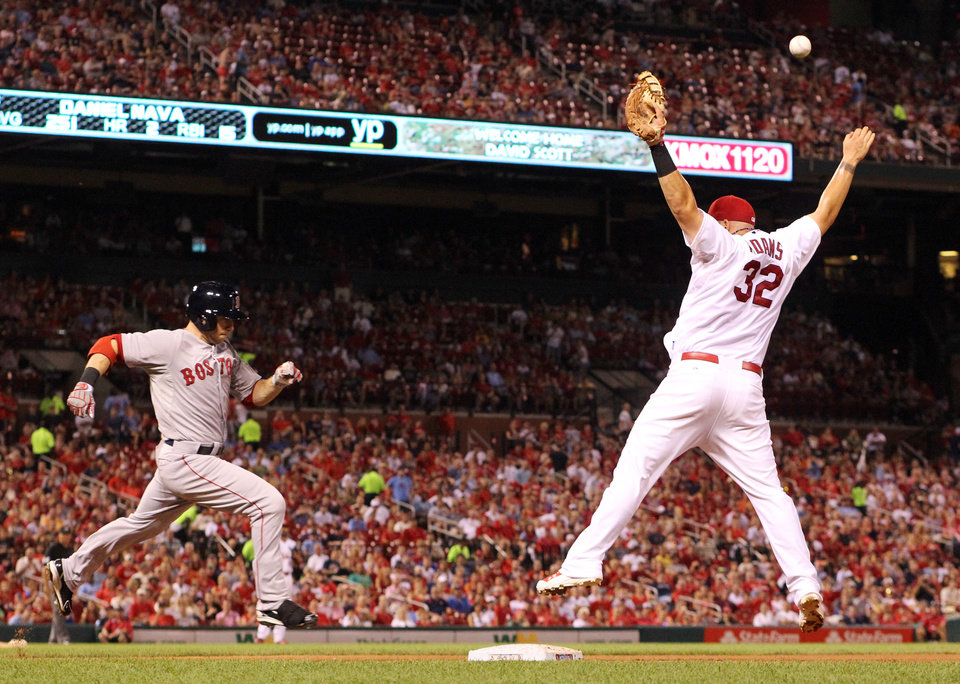 Photo - Boston Red Sox's Daniel Nava, left, reaches first as St. Louis Cardinals first baseman Matt Adams is unable to reach third baseman Matt Carpenter's high throw during the fifth inning of a baseball game Tuesday, Aug. 5, 2014, in St. Louis. (AP Photo/St. Louis Post-Dispatch, Chris Lee)