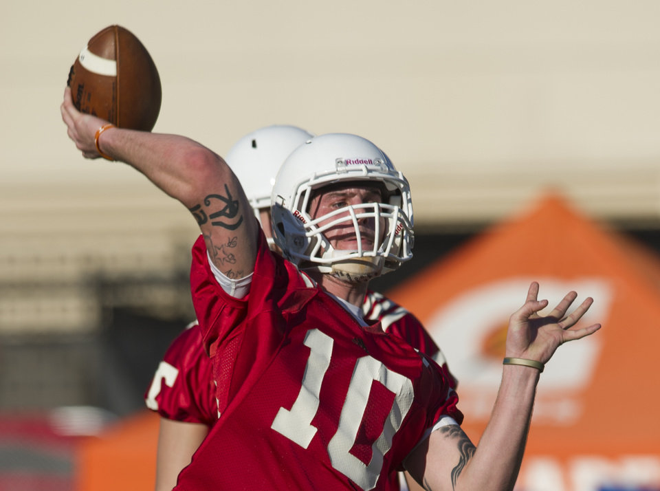 Photo - In this March 7, 2014 photo, Tennessee quarterback Riley Ferguson throws a pass during an NCAA college spring practice in Knoxville, Tenn. Tennessee coach Butch Jones is still waiting for someone to separate themselves from the rest in the Volunteers' four-man quarterback competition as spring practice draws to a close. (AP Photo/The Knoxville News Sentinel, Paul Efird)