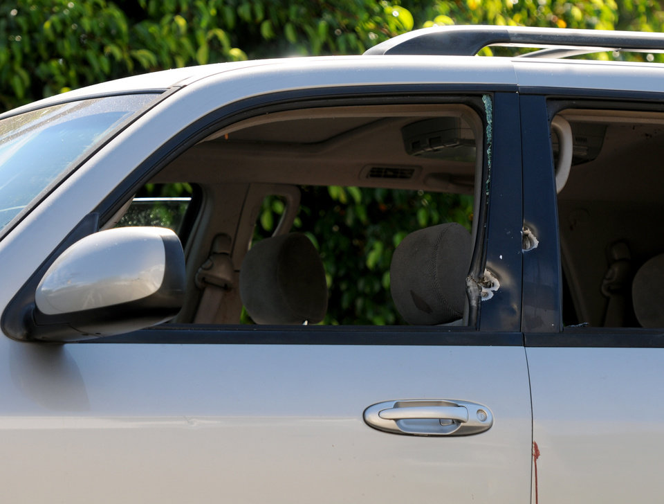 """Photo - A vehicle has bullet holes at the scene of a shooting where one person was killed and two were injured in San Fernando, on Sunday, Aug. 24, 2014. Describing what they called """"a major public threat,"""" Los Angeles police said they are seeking clues to three separate shootings in the Northeast San Fernando Valley that left three people dead and four others injured early Sunday morning and appear to be connected. A suspect in the shootings was taken into custody by SWAT officers Sunday night after holing up inside a house in the Sylmar neighborhood for about an hour, Capt. William Hayes said. The three incidents, which were described as having """"a similar manner,"""" took place between 5:50 and 6:45 a.m. Sunday in the city of San Fernando and in the Los Angeles communities of Sylmar and Pacoima, Los Angeles Police Department officials said. (Photo by Dean Musgrove/Los Angeles Daily News)"""