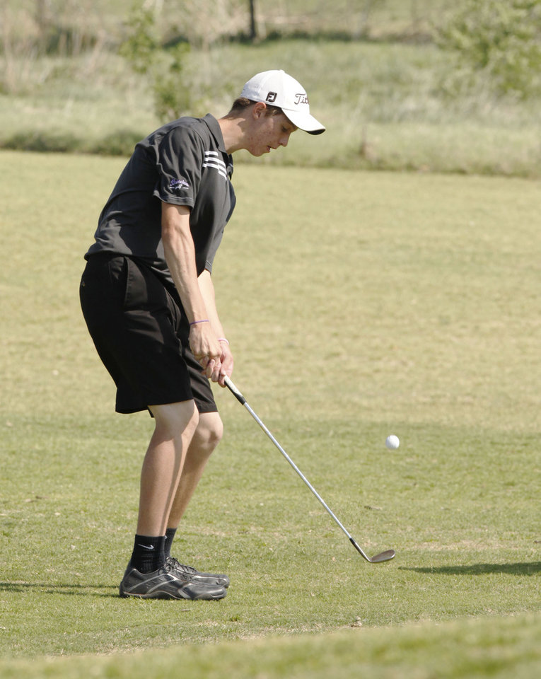 Bethany\'s Tanner Stiles chips a shot onto the green during a boys high school 4A golf tournament at Lake Hefner Golf Course in Oklahoma City, OK, Monday, May 9, 2011. By Paul Hellstern, The Oklahoman