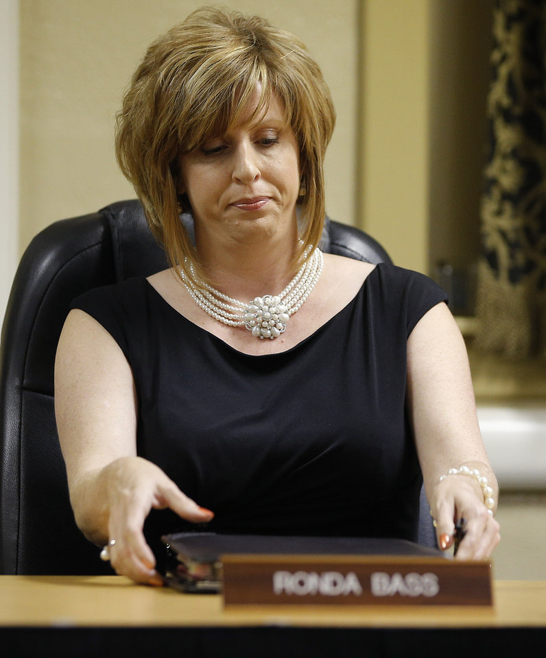Photo - Noble schools Superintendent Ronda Bass gathers her items Tuesday as she leaves the Noble Board of Education meeting.  Bryan Terry - THE OKLAHOMAN