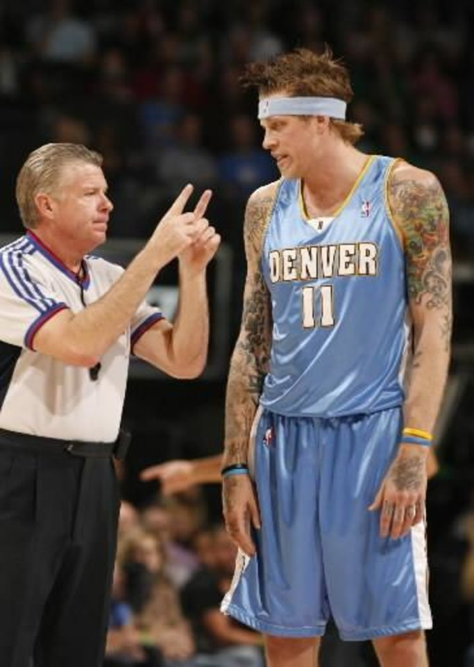 Photo - Chris  Andersen is called for a foul in the first half as the Oklahoma City Thunder play the Denver Nuggets at the Ford Center in Oklahoma City, Okla. on Friday, January 2, 2009. By Steve Sisney