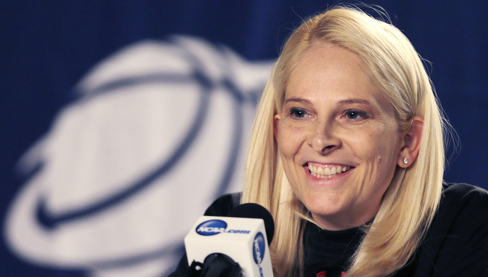 Photo - Maryland head coach Brenda Frese smiles during a news conference prior to practice for a women's regional semifinal game in the NCAA college basketball tournament in Bridgeport, Conn., Friday, March 29, 2013. Maryland plays Connecticut Saturday. (AP Photo/Charles Krupa)