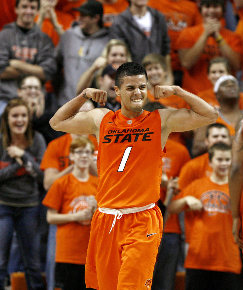 Oklahoma State's Cezar Guerrero celebrates during an NCAA college basketball game between the Oklahoma State University Cowboys (OSU) and the University of Texas-San Antonio Roadrunners at Gallagher-Iba Arena in Stillwater, Okla., Wednesday, Nov. 16, 2011. Photo by Bryan Terry, The Oklahoman