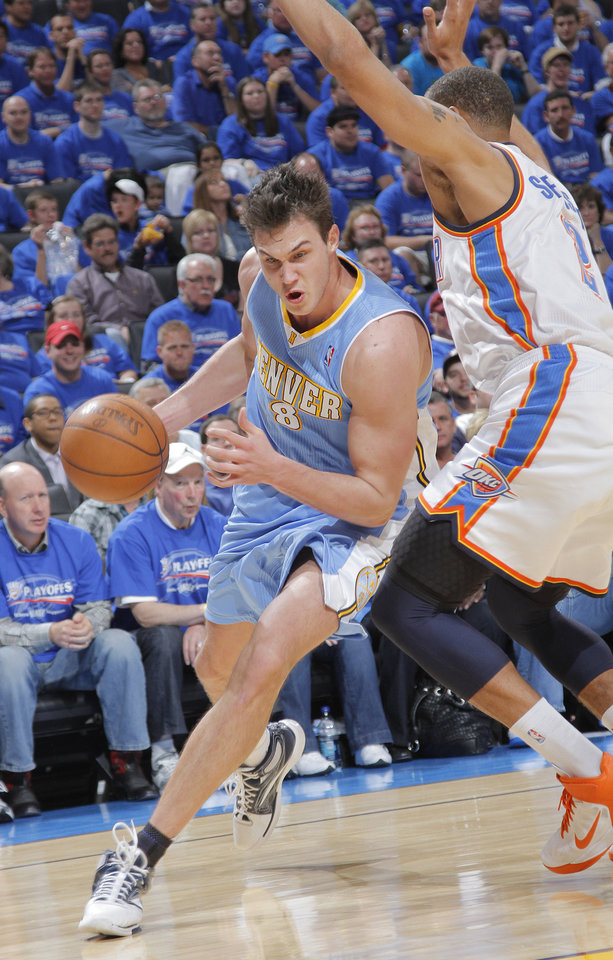 Photo - Denver's Danilo Gallinari (8) drives past Oklahoma City's Thabo Sefolosha (2) during the first round NBA playoff game between the Oklahoma City Thunder and the Denver Nuggets on Sunday, April 17, 2011, in Oklahoma City, Okla. Photo by Chris Landsberger, The Oklahoman