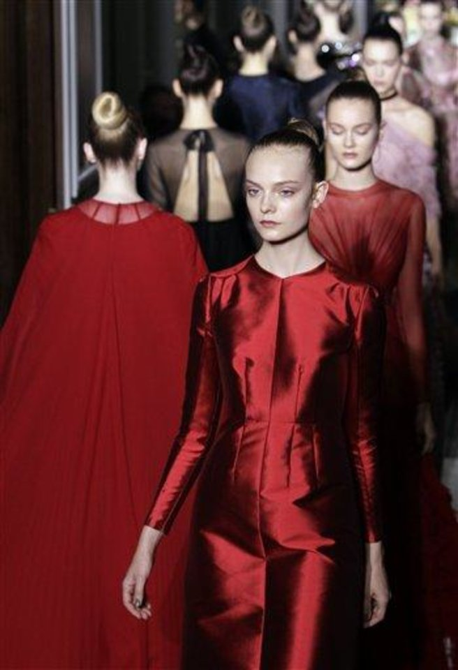 Models wear creations by fashion designers Maria Grazia Chiuri and Pier Paolo Piccioli for Valentino during Women's Fall Winter 2012-2013 haute couture fashion collection in Paris, France, Wednesday, July 4, 2012. (AP Photo/Francois Mori)