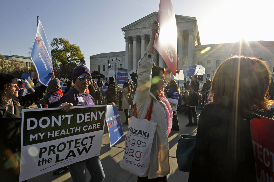 Photo -   Supporters of health care reform rally in front of the Supreme Court in Washington, Tuesday, March 27, 2012, as the court continued hearing arguments on the health care law signed by President Barack Obama. (AP Photo/Charles Dharapak)