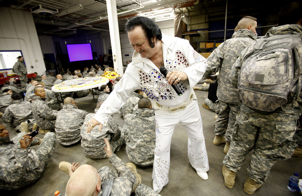 Elvis entertain soldiers from Ft. Sill as they wait for flights home for the holidays at the YMCA Military Welcome Center at Will Rogers World Airport, Saturday, Dec. 18, 2010, in Oklahoma City. Photo by Sarah Phipps, The Oklahoman