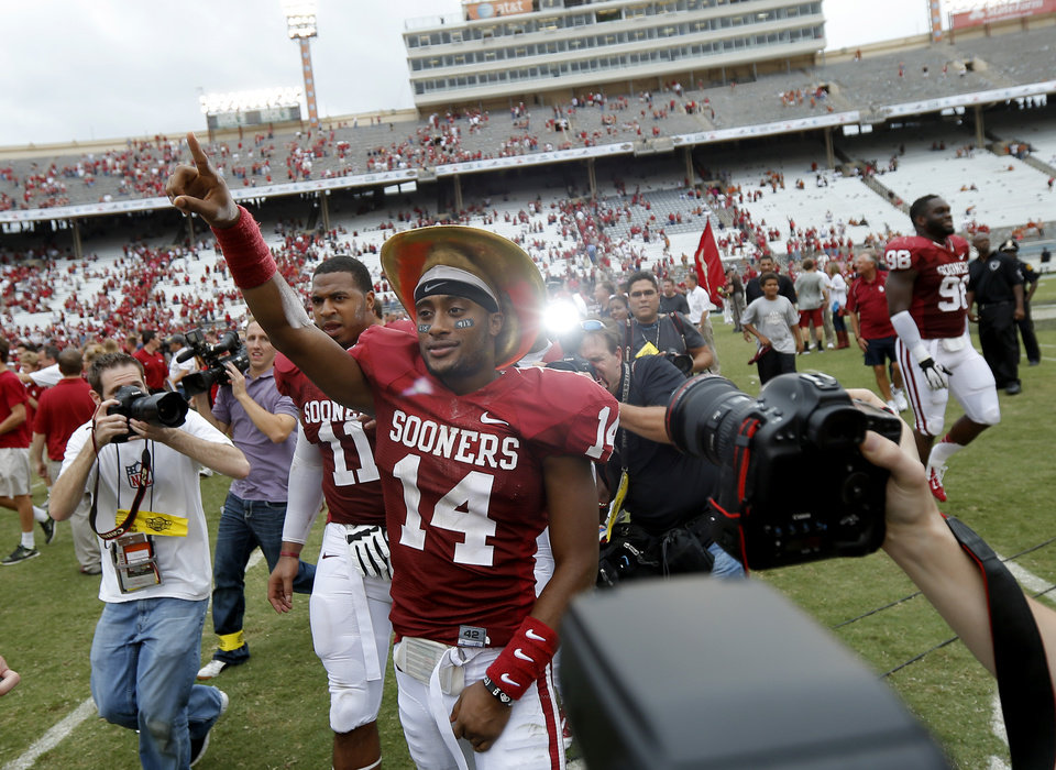 Photo - OU's Aaron Colvin (14) celebrates after the Red River Rivalry college football game between the University of Oklahoma (OU) and the University of Texas (UT) at the Cotton Bowl in Dallas, Saturday, Oct. 13, 2012. Oklahoma won 63-21. Photo by Bryan Terry, The Oklahoman