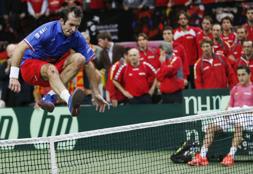 Photo -   Czech Republic's Radek Stepanek celebrates by jumping over the net after defeating Spain's Nicolas Almagro in their Davis Cup finals tennis singles match in Prague, Czech Republic, Sunday, Nov. 18, 2012. Czech Republic defeated Spain 3-2 and gained the Davis Cup trophy. (AP Photo/Petr David Josek)