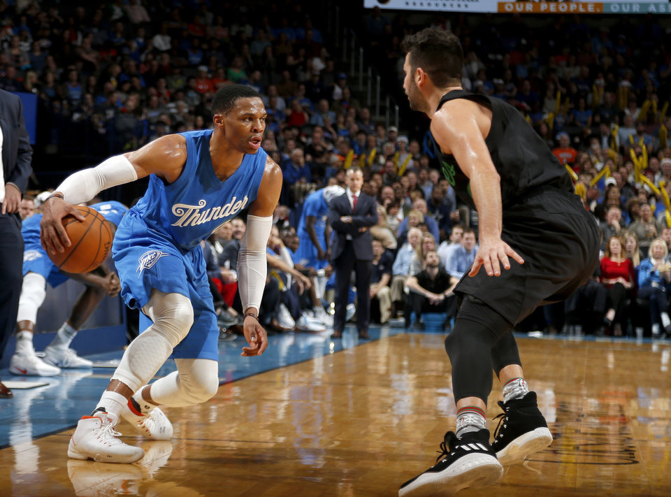 Photo - Oklahoma City's Russell Westbrook (0) looks to drive to the basket past Minnesota's Ricky Rubio (9) during the NBA game between the Oklahoma City Thunder and the Minnesota Timberwolves at the Chesapeake Energy Arena,  Sunday, Dec. 25, 2016. Photo by Sarah Phipps, The Oklahoman